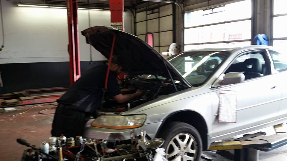 car expert servicing car at elk river auto shop